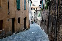 Narrow Alley With Old Buildings In Medieval Town of Siena, Tuscany, Italy Stock Photo - Royalty-Freenull, Code: 400-06557640