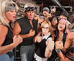 Motorcycle gang and female nerd holding up fists in bar Stock Photo - Royalty-Free, Artist: creatista, Code: 400-06557775