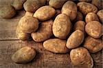 Fresh potatoes on rustic wooden background Stock Photo - Royalty-Free, Artist: Sandralise                    , Code: 400-06558239