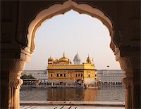 punjabi - Amritsar Golden Temple - India. Framed with windows from west side. focus on temple Stock Photo - Royalty-Freenull, Code: 400-06558377
