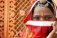 Traditional Indian woman in sari costume covered her face with veil, India Stock Photo - Royalty-Freenull, Code: 400-06558383