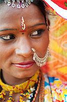 Traditional Indian woman in sari costume looking away, India Stock Photo - Royalty-Freenull, Code: 400-06558384