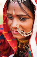 Young Traditional Indian woman in sari costume covered her head with veil, India Stock Photo - Royalty-Freenull, Code: 400-06558387