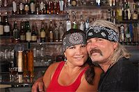 Cute motorcycle gang husband and wife together in bar Stock Photo - Royalty-Freenull, Code: 400-06558624