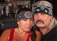 Serious middle aged couple in bandannas at a bar Stock Photo - Royalty-Freenull, Code: 400-06558625