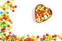Multicolor candies in heart shape candy box on white background Stock Photo - Royalty-Freenull, Code: 400-06560576