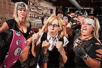 Motorcycle gang members force a fight with nerd in bar Stock Photo - Royalty-Freenull, Code: 400-06561339