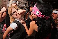 Female nerd with eyeglasses punched in fight with gang Stock Photo - Royalty-Freenull, Code: 400-06561340