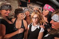 Cruel gang of mature women teasing a nerd in a bar Stock Photo - Royalty-Freenull, Code: 400-06561343