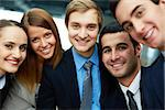 Portrait of five business partners looking at camera with smiles Stock Photo - Royalty-Free, Artist: pressmaster                   , Code: 400-06564462