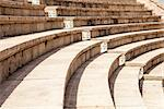 The Roman theater at Caesaria in Israel has been restored and is now used for modern performances. The tiered rows of seating provide a clean, repetitive pattern that arcs into the distance. Stock Photo - Royalty-Free, Artist: searagen                      , Code: 400-06564775