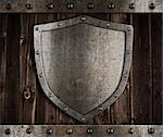 aged metal shield on wooden medieval gates Stock Photo - Royalty-Free, Artist: andrey_kuzmin                 , Code: 400-06566411