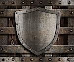aged metal shield on wooden medieval gates Stock Photo - Royalty-Free, Artist: andrey_kuzmin                 , Code: 400-06566412