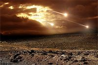 Some meteors rain from the sky through clouds Stock Photo - Royalty-Freenull, Code: 400-06567932