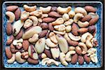 Rectangular plate with roasted, salted nuts Stock Photo - Premium Royalty-Free, Artist: Andrew Kolb, Code: 600-06570961