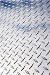 Low angle view of stainless steel diamond plate facade with reflection of clouds Stock Photo - Premium Royalty-Free, Artist: Andrew Kolb, Code: 600-06570964