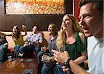Men and women socializing in a bar in the city. Group of festive, smiling people celebrating with drinks. California USA Stock Photo - Premium Royalty-Free, Artist: Mitch Tobias, Code: 600-06571137