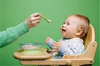 Adult feeding baby Stock Photo - Premium Royalty-Freenull, Code: 6114-06589328