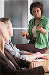 Woman having discussion with colleagues Stock Photo - Premium Royalty-Free, Artist: Ikon Images, Code: 6114-06589447