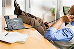Man on telephone in office Stock Photo - Premium Royalty-Freenull, Code: 6114-06589460
