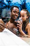 A couple in a hot tub with wine Stock Photo - Premium Royalty-Free, Artist: Michael Mahovlich, Code: 6114-06589462