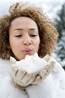 Woman blowing snow Stock Photo - Premium Royalty-Freenull, Code: 6114-06589465
