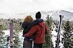 Rear view of couple looking at view Stock Photo - Premium Royalty-Free, Artist: Blend Images, Code: 6114-06589467