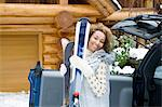 Woman holding skis Stock Photo - Premium Royalty-Free, Artist: Blend Images, Code: 6114-06589492