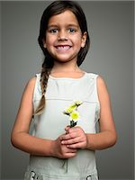 Girl holding flowers Stock Photo - Premium Royalty-Freenull, Code: 6114-06589505