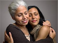 Mother and daughter hugging Stock Photo - Premium Royalty-Freenull, Code: 6114-06589512