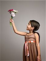 Girl holding flowers Stock Photo - Premium Royalty-Freenull, Code: 6114-06589516