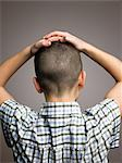 Boy with hands on his head Stock Photo - Premium Royalty-Free, Artist: Aflo Relax, Code: 6114-06589526
