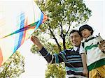 Father and son playing with a kite Stock Photo - Premium Royalty-Free, Artist: Blend Images, Code: 6114-06589546