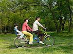 Family on a tandem bike Stock Photo - Premium Royalty-Freenull, Code: 6114-06589552