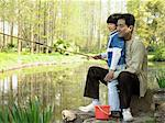Father and son fishing Stock Photo - Premium Royalty-Free, Artist: Westend61, Code: 6114-06589554