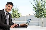 Businessman using laptop Stock Photo - Premium Royalty-Free, Artist: Kevin Dodge, Code: 6114-06589571