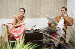 Couple sitting and looking away Stock Photo - Premium Royalty-Free, Artist: Blend Images, Code: 6114-06589627