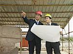 Businessmen on a building site Stock Photo - Premium Royalty-Free, Artist: Blend Images, Code: 6114-06589648