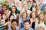 People in a crowd with their hands raised Stock Photo - Premium Royalty-Free, Artist: Westend61, Code: 6114-06589702