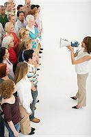 Woman ordering crowd Stock Photo - Premium Royalty-Freenull, Code: 6114-06589715