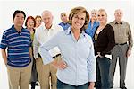 Woman in front of crowd Stock Photo - Premium Royalty-Free, Artist: Blend Images, Code: 6114-06589748