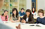 Teenagers in classroom Stock Photo - Premium Royalty-Free, Artist: Blend Images, Code: 6114-06589806