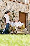 Grandmother and granddaughter in garden Stock Photo - Premium Royalty-Free, Artist: Blend Images, Code: 6114-06589842