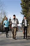 People walking with poles Stock Photo - Premium Royalty-Free, Artist: Blend Images, Code: 6114-06589944