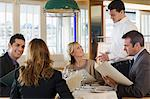 Colleagues in a restaurant Stock Photo - Premium Royalty-Free, Artist: Cultura RM, Code: 6114-06589978