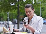 Woman with lunch and cellphone Stock Photo - Premium Royalty-Free, Artist: Blend Images, Code: 6114-06589994