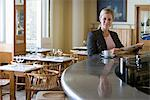 Woman in cafe Stock Photo - Premium Royalty-Free, Artist: Blend Images, Code: 6114-06589996