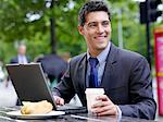 Businessman with lunch and laptop Stock Photo - Premium Royalty-Free, Artist: Ikon Images, Code: 6114-06589997