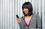 Young woman using cell phone Stock Photo - Premium Royalty-Free, Artist: Boone Rodriguez, Code: 6114-06590006
