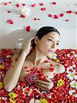 Young woman bathing Stock Photo - Premium Royalty-Free, Artist: Cultura RM, Code: 6114-06590062